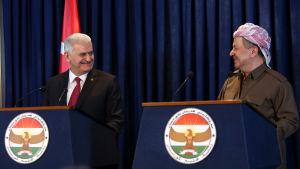Turkiets premiärminister Binali Yıldırım besöker Irakiska Kurdistans president Massoud Barzani i Erbil i januari 2017.