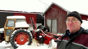 Lantbrukare med traktor