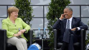 Angela Merkel och Barack Obama uppträder inför publik tillsammans i Berlin den 20 maj 2017.