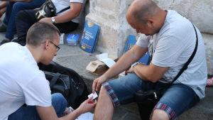 I centrum av Belgrad byter många Paninikort ägare