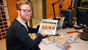 Doktorand Kaj Ahlsved forskar i musikanvändningen inom sport. 2015.
