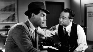 Fred MacMurray ja Edward G. Robinson elokuvassa Nainen ilman omaatuntoa (1944).