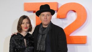 British actor Ewan McGregor (R) poses with British actress Kelly Macdonald (L) on the red carpet arriving to attend the world premiere of the film T2 Trainspotting in Edinburgh on January 22, 2017.