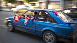Tunisians wave national flags from the windows of their car downtown Tunis, Tunisia, on 23 October 2011. According to media sources, voters in Tunisia thronged polling stations for the country's first-ever free elections, nine months after the overthrow o