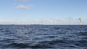 Illustration av vindkraftverk i Helsingfors yttre skärgård, Mjölö i bakgrunden.
