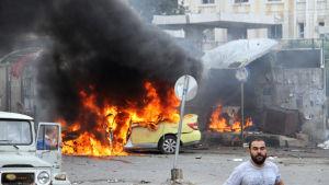 Ett femtiotal människor dödades i Tartus i självmordsattacker mot bland annat en bensin- och bussstation i stadskärnan
