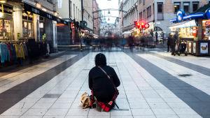 Rumänsk tiggare på gatan.