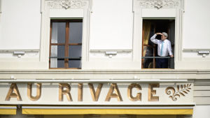 John Kerry spanar ur hotellrum i Lausanne.