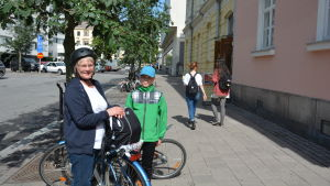 Two cyclists, a woman and a boy