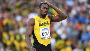 Usain Bolt håller sig för huvudet