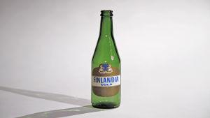 Lasimuseon kokoelmasta olutpullo