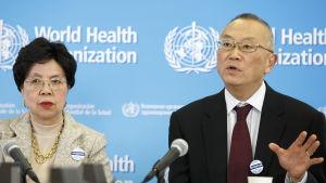 Margaret Chan och  Keiji Fukuda.