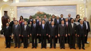 21 länder möttes i oktober 2014 för att grunda AIIB