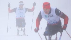 Grigorij Murygin och Alexej Bytjenok tävlade i skidskytte i de paralympiska spelen i Sotji.