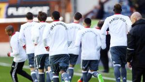Uniteds spelarna hade Rojos och Ibrahimovic namn på ryggen under uppvärmningen på veckoslutet.