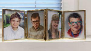 Jyrki Pinomaas fyra barn i porträttform på fönsterbrädet.