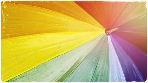 Kuvituskuva: sateenvarjo, jossa sateenkaaren värit.
