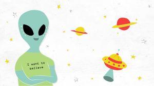 Avaruusolento, jolla lukee t-paidassa I want to believe.