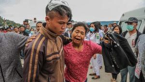 En mamma grät i tisdags då hon återförenades med sin unga son som tillhör fåtalet överlevande efter färjeolyckan.