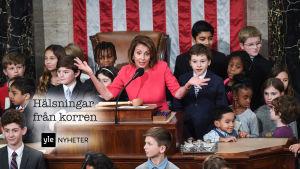 Representanthusets nyvalda talman Nancy Pelosi med barnbarn.