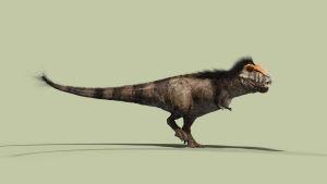 Tyrannosaurus Rexin pienoismalli vihreällä taustalla
