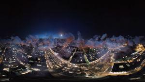 Tyylitelty ilmakuva kaupungistä yöllä.