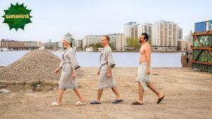 Tuija Pehkonen, Mikko Kekäläinen ja Gogi Mavromichalis kävelevät peräkkäin.