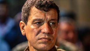 General Mazloum Abdi deltog i ett möte tillsammans med andra syriska och amerikanska officerare i staden Hasakah den 24 augusti, innan president Trump beslöt att dra bort de amerikanska soldaterna från norra Syrien.