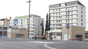 Öde torg i Jakobstad med höghus i bakgrunden.