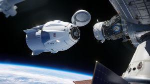 Rymdkapseln Crew Dragon dockar vid Internationella rymdstationen.
