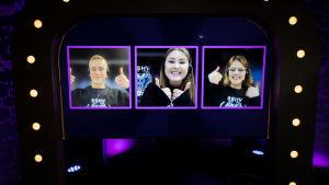 En skärm som visar tre personer i varsin ruta. De deltar i en tävling visa webkameran på sin dator.