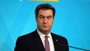 CSU:s ledare Markus Söder försäkrar att han nöjer sig med CDU:s beslut.