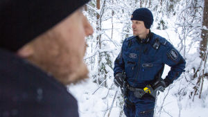 Kimmo Örn från Vargpatrullen. I förgrunden skymtar också Tobias Peura.