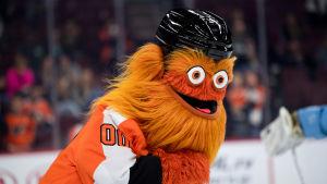 "Philadelphia Flyers nya orangehåriga NHL-maskot ""Gritty"" med svart hjälm."