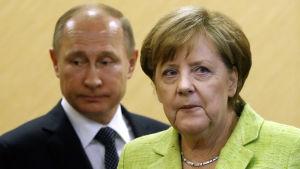 Vladimir Putin och Angela Merkel.