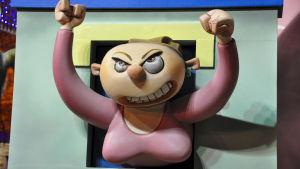 Målning av arg kvinna på gatufestivalen Las Fallas i Valencia.