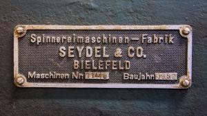 En skylt för spinnerimaskintillverkaren Seydel & co.