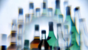 Wine and hard liquor bottles photographed through a multiprism filter