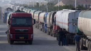 Kina lovar att följa ny FN-sanktioner och att begränsa oljeexporten till sin isolerade bundsförvant