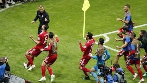 De iranska spelarna jublade länge innan de insåg att Ezatolahis mål mot Spanien hade dömts bort på grund av offside.