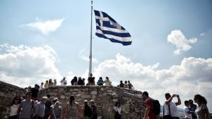 grekiska turister på akropolis