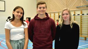 Porträtt av Ellen Enkvist, Emil Österback och Jasmin Forsten.