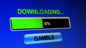 Dataskärm med orden Gamble (satsa) och Downloading (laddar ner).
