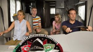 Familjen sitter i sin bil