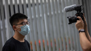 Joshua Wong talade till reportrar i Hongkong den 28 maj.