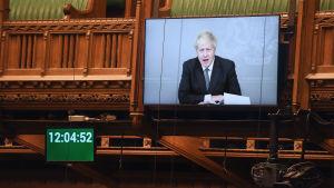 Boris Johnson, som befinner sig i karantän,  talar på distans inför parlamentet 18.11.2020