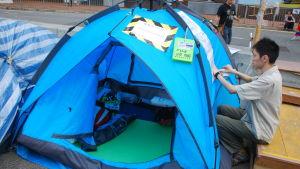 Tommy Chen blockerar för fem år sedan en av huvudgatorna med tält för att få Kina att bevilja Hongkong fullskalig demokrati.