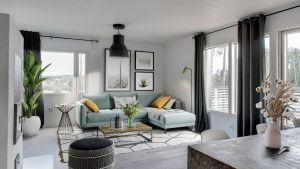Virtuaalisesti sisustettu olohuone: tyhjään huoneeseen on luotu virtuaalisesti huonekaluja, tauluja ja kasveja.