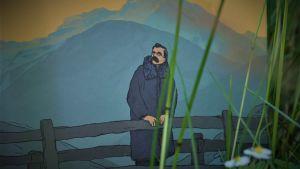 Seriealbum där Nietzsche står på en bro, alptoppar i bakgrunden, Boken fotad i gräs med smultronblomma i förgrunden