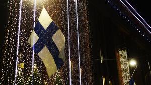 Finlands flagga med glitter omkring.